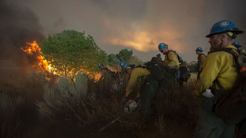 Firefighters of the Texas Canyon Hotshot crew fight the Sand Fire on July 23 2016 near Santa Clarita, California.