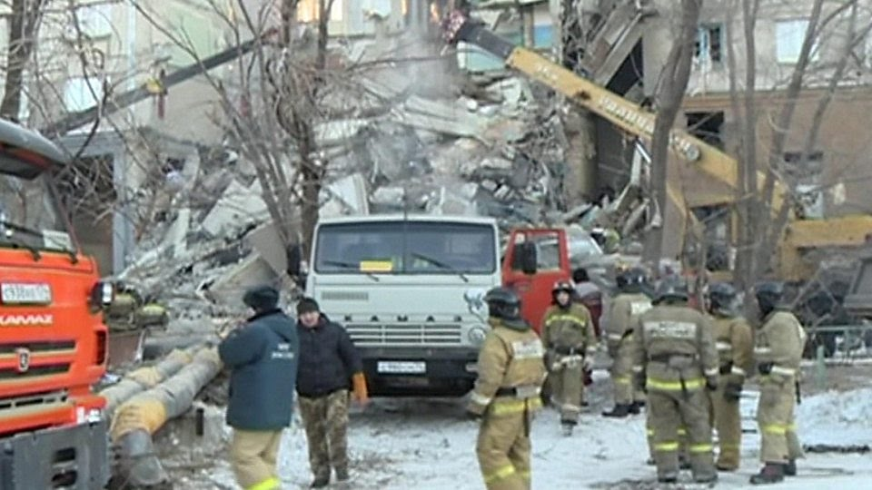 Rescuers search for survivors after a gas explosion in a Russian apartment block