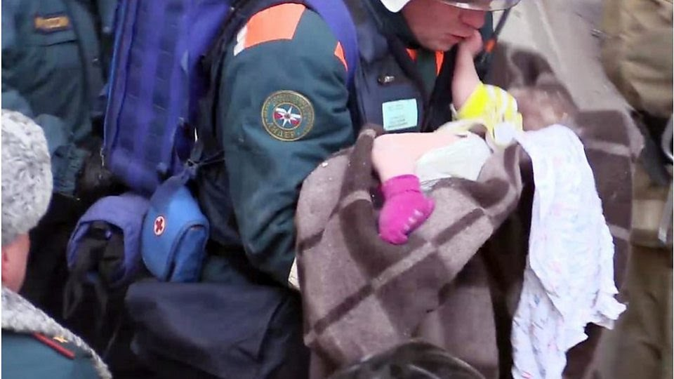 Magnitogorsk: Russian rescuers pull baby from rubble