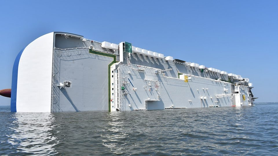 Trapped crew rescued from capsized cargo ship