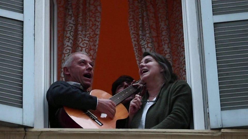 Coronavirus: Italians sing from their windows to boost morale