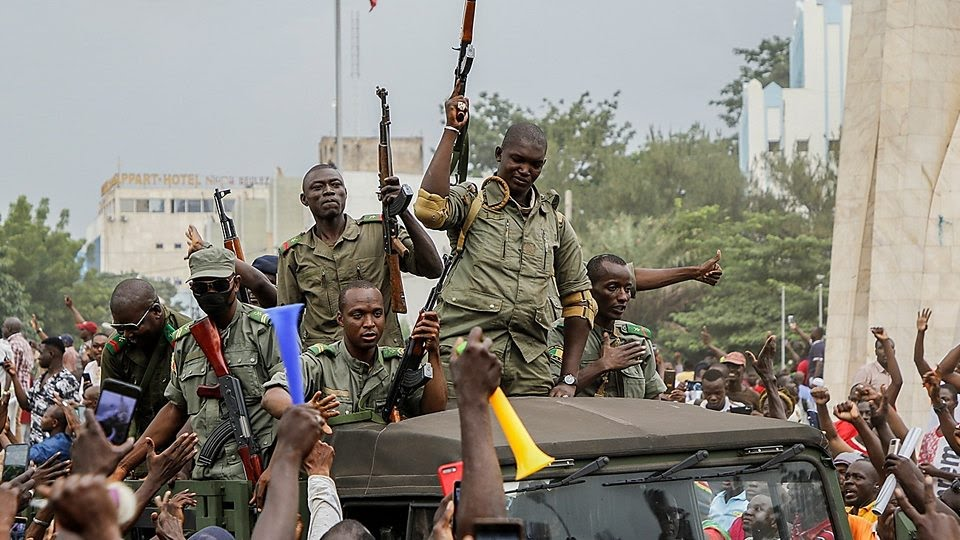 The mutinying soldiers were cheered by crowds as they reached the capital Bamako
