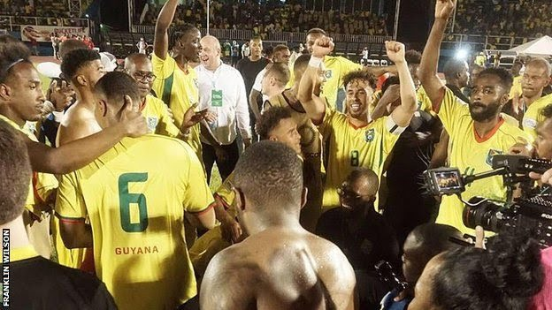Guyana players celebrate after beating Belize to qualify for the Gold Cup