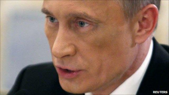 Russian Prime Minister Vladimir Putin appears before the press in Kiev, 27 October