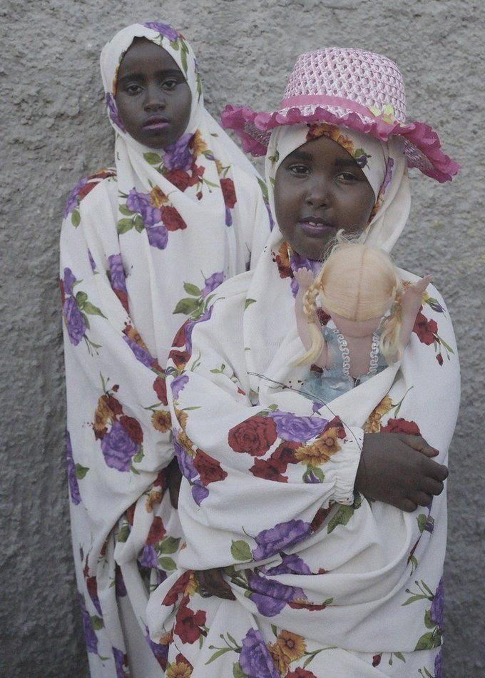 Girls holding dolls
