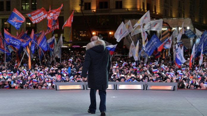 Russian President and Presidential candidate Vladimir Putin attends a rally and concert marking the fourth anniversary of Russia