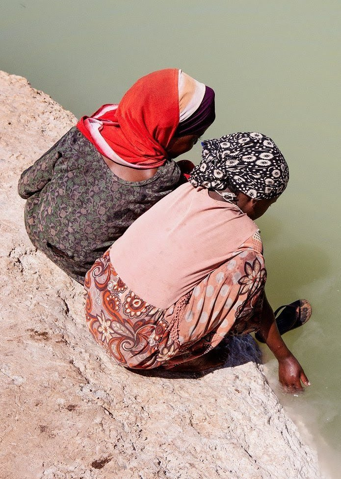 Two women looking into the water