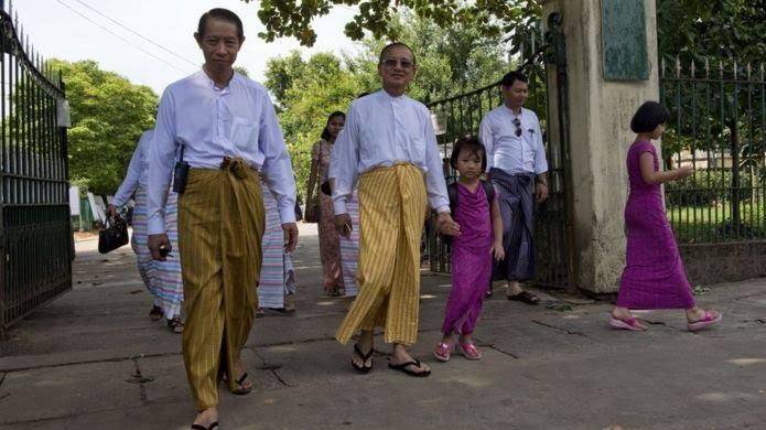 Men wearing longyi in Myanmar (file image)