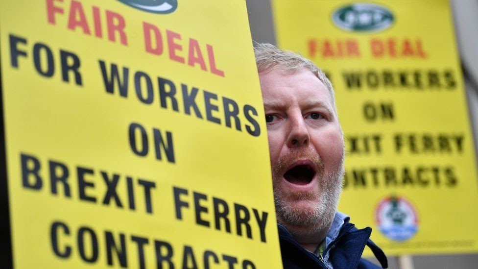 A demonstrator shouts outside the Department for Transport in London on January 11, 2019 to demand assurances of fair conditions for workers under ferry contracts created because of Brexit and specifically following the award of the Seaborne Freight contract