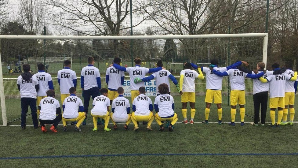 The under-19s at FC Nantes pose for pictures - wearing t-shirts with the words 'We Love You Emi'