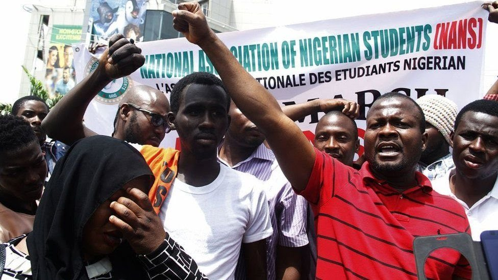 Nigerian students shout slogans against South Africa as they protest outside the South African Digital Satellite TV's (DSTV) Nigerian headquarters in Abuja against the recent spike in attacks targeting foreign nationals in South Africa on February 23, 2017