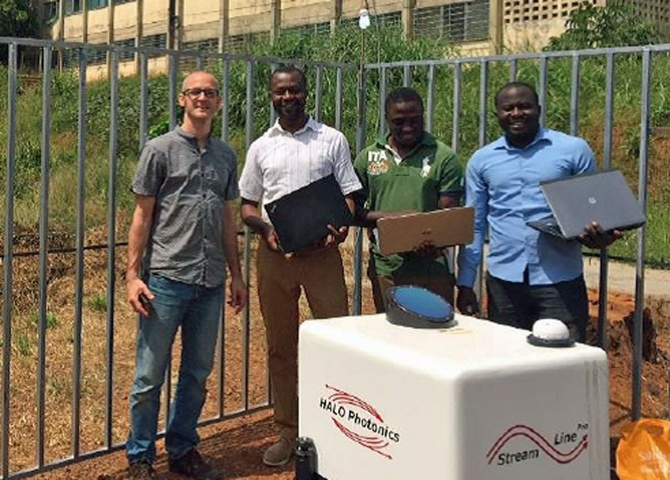 Climate specialists: L-R: Sebastian Engelstaedter, Wilfried Pokam, Giresse Kuete, Thierry Taguela with a Lidar in Yaounde, Cameroon