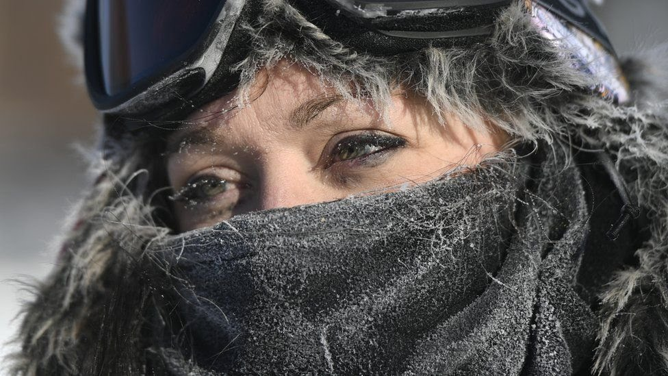 A woman in Minneapolis bundled up in ski gear