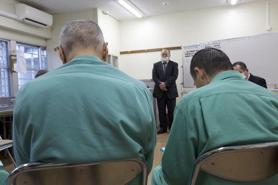 Prisoners attend a class
