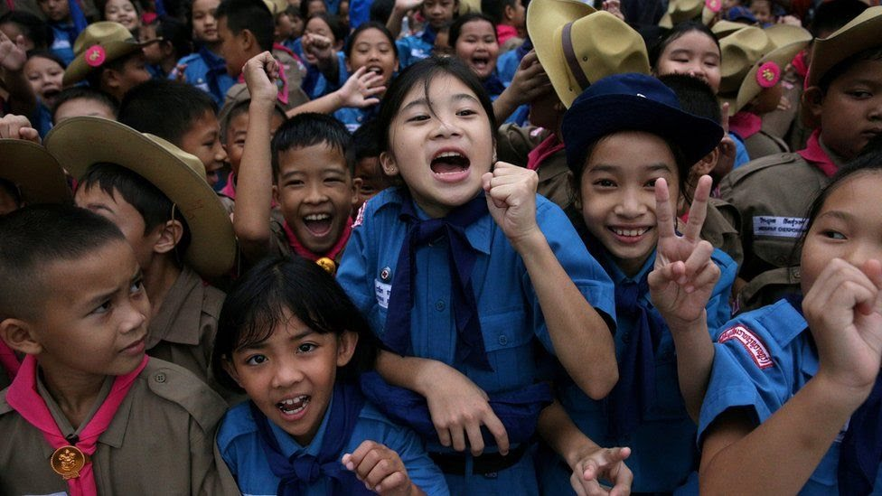 Students celebrate in front of Chiang Rai Prachanukroh hospital, where the 12 soccer players and their coach rescued from the Tham Luang cave complex are being treated, 11 July 2018