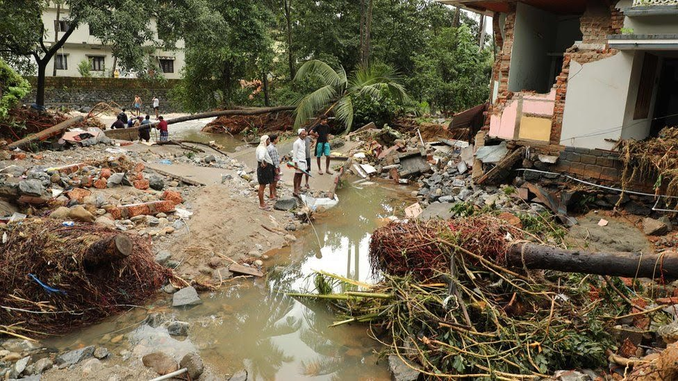 Residents in Kerala look at the devastation caused by flooding, August 2018