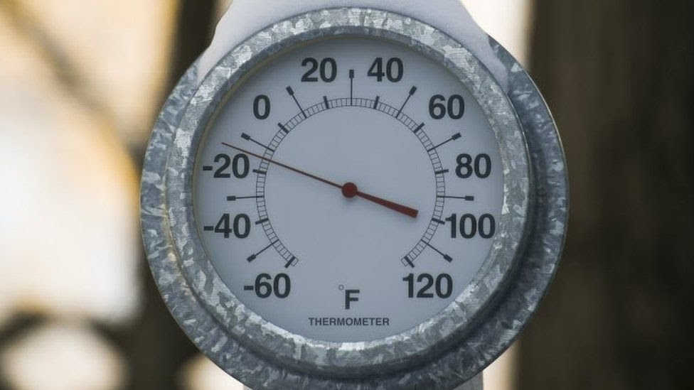 A thermometer shows temperature of around -20 degrees F