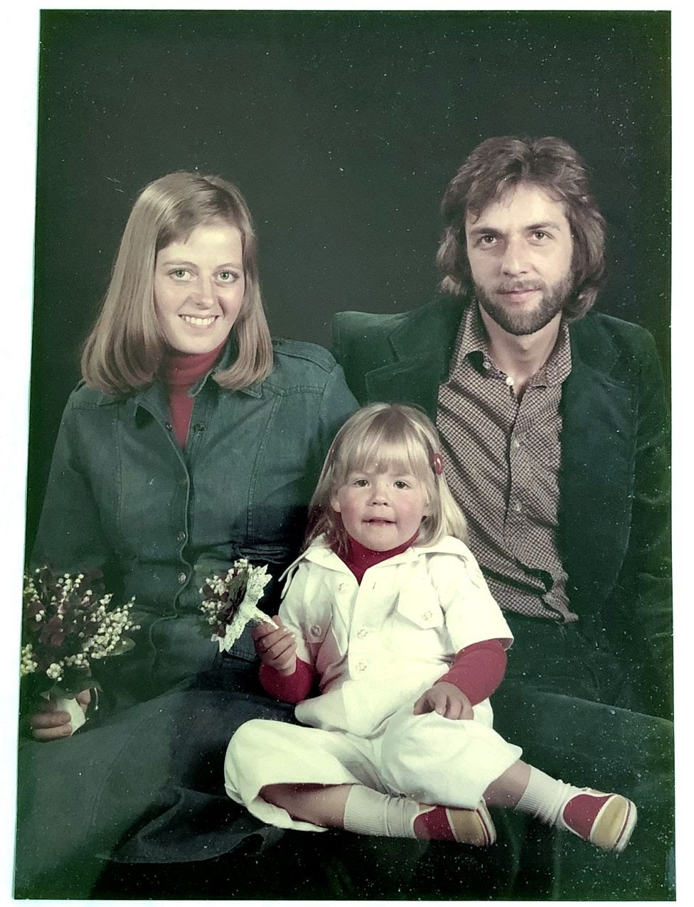 Anna, with her parents