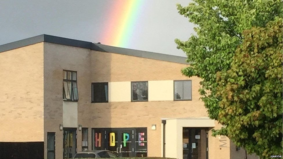 Rainbow above building displaying hope sign in Wickford, in Essex