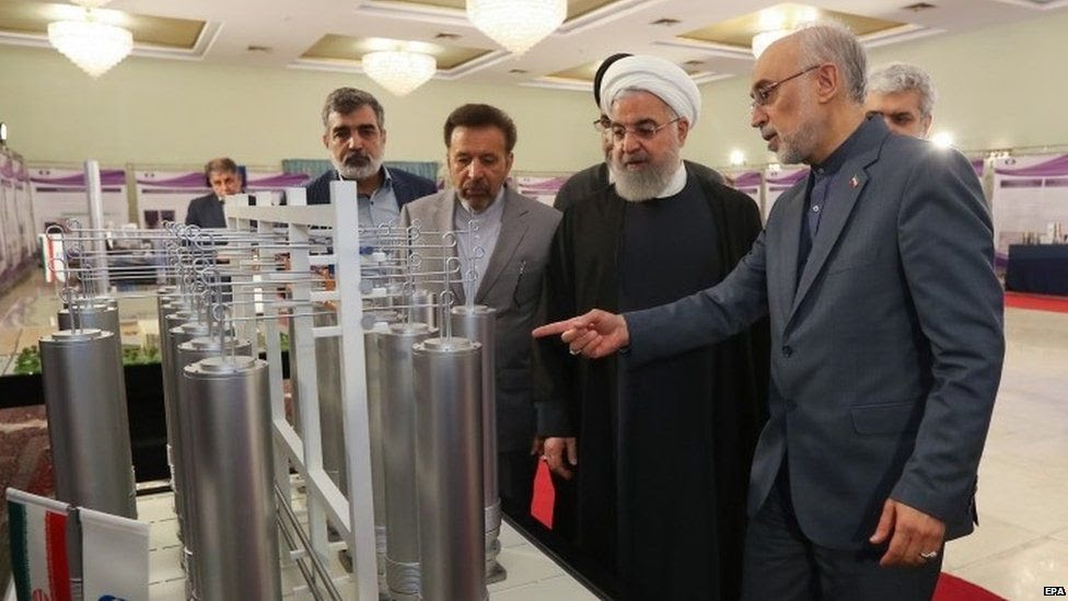 An Iranian government picture showing President Hassan Rouhani and the head of Iran nuclear technology organization Ali Akbar Salehi inspecting nuclear technology