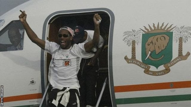 Drogba emerges from the plane that flew the victorious Ivory Coast team home from Sudan