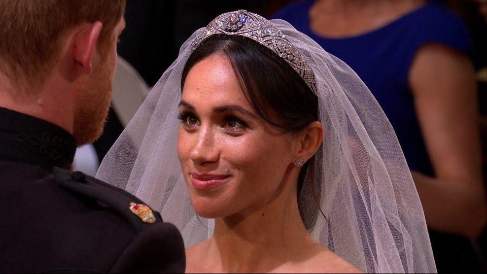 The moment Prince Harry lifts Meghan's veil