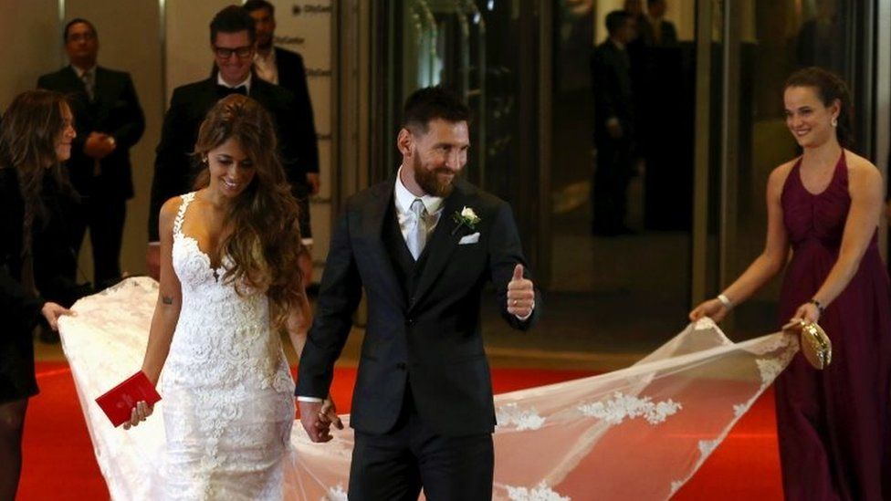 Argentine soccer player Lionel Messi and his wife Antonela Roccuzzo make an appearance for the press at their wedding in Rosario, Argentina, 30 June 2017.